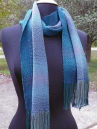 Draped scarf.