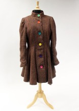 Colorful buttons give the jacket a playful attitude.